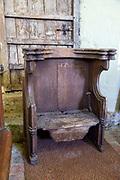 Historic furniture misericord chair inside Church of Saint Lawrence, Brundish, Suffolk, England, UK
