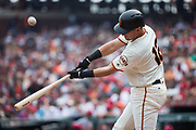 San Francisco Giants second baseman Joe Panik (12) connects with a St. Louis Cardinals pitch at AT&T Park in San Francisco, California, on September 3, 2017. (Stan Olszewski/Special to S.F. Examiner)