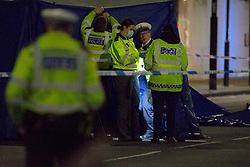 @ Licensed to London News Pictures. 19/10/2020. London, UK. Emergency services at the scene where a woman was killed by a motorcyclist in Islington, north London. Photo credit: Marcin Nowak/LNP