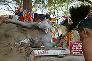 A naga sadhu at Kumbh Mela in Ujjain, India, doing yoga and giving blessing with a feather duster to people who approach with donations. The sign says his name is Mahan Birij, welcome, and that he is the disciple of Sivaratri. The Kumbh Mela festival is a sacred Hindu pilgrimage held 4 times every 12 years, cycling between the cities of Allahabad, Nasik, Ujjain and Hardiwar. Past Melas have attracted up to 70 million visitors. (Supporting image from the project Hungry Planet: What the World Eats.)