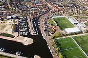 Nederland, Utrecht, Bunschoten-Spakenburg, 01-05-2013;<br /> Jachthaven met aangemeerde zeilboten, nieuwbouwwijk met huizen in oude stijl en Sportpark de Westmaat,het voetbalveld en -stadion van de IJsselmeervogels aan de Westdijk.<br /> Marina with moored sailboats, new neighbourhood with old style houses and the sporting grounds Westmaat, the football field and stadium of the local football club.<br /> luchtfoto (toeslag op standard tarieven)<br /> aerial photo (additional fee required)<br /> copyright foto/photo Siebe Swart