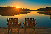 Muskoka chairs on Snake Island Lake (Cassels Lake) at sunrise<br />Temagami<br />Ontario<br />Canada