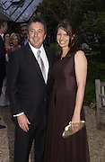 Mr. and Mrs. ( Lauren) Mark Booth, Cartier Flower show dinner, Chelsea Physic garden, 24 May 2004. ONE TIME USE ONLY - DO NOT ARCHIVE  © Copyright Photograph by Dafydd Jones 66 Stockwell Park Rd. London SW9 0DA Tel 020 7733 0108 www.dafjones.com
