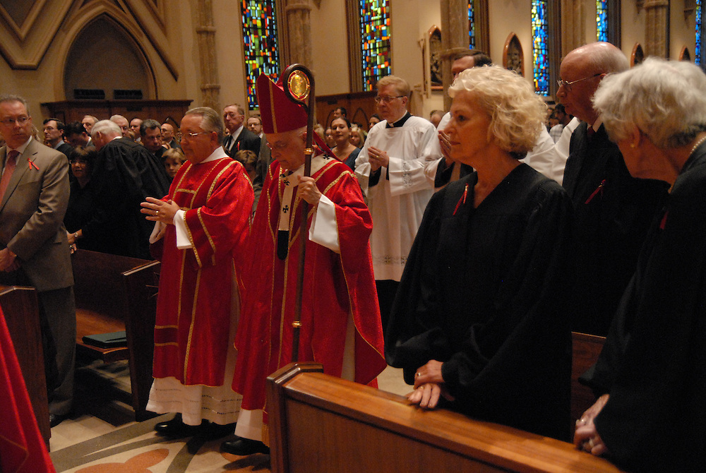 Members of Chicago's legal community, including Illinois Supreme Court Justice Anne M. Burke (center right), are gathered for the Catholic Lawyers Guild Annual Red Mass at Holy Name Cathedral, celebrated by Francis Cardinal George (center left).