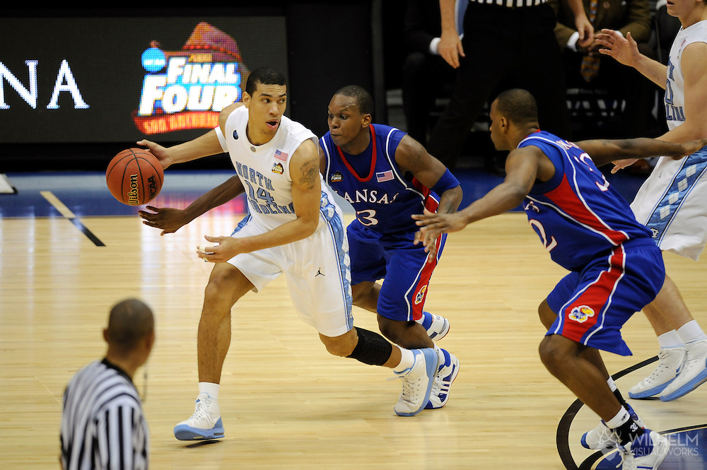 5 APR 2008: Russell Robinson (3) of the University of Kansas and Danny Green (14) of the University of North Carolina clash during semifinal game of the 2008 NCAA Final Four Division I Men's Basketball championships held at the Alamodome in San Antonio, TX.  Kansas defeated North Carolina 84-66 to advance to the championship game.  © Brett Wilhelm