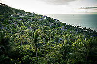 A view over the Four Seasons resort, nestled amidst dense forests and coconut trees on Koh Samui island in southern Thailand.
