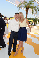 RAYMOND BLANC and NATALIA TRAXEL at the Veuve Clicquot Gold Cup, Cowdray Park, Midhurst, West Sussex on 21st July 2013.