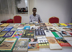 © Licensed to London News Pictures. 4/08/2015. Hargeisa, Somaliland.  A young book seller sits behind his stall as people come to browse during the International Hargeisa Book Festival in the city of Hargeisa within the Republic of Somaliland this week (1 - 6 Aug). <br /> <br /> Over 700 guests are expected to attend along with renowned poets, writers and musicians from both Somaliland, Nigeria and the UK.  As well as the book fair the Women of the World (WOW) event, hosted by Jude Kelly, the Artistic Director of the Southbank Centre in London was held for the first time in the Horn of Africa.   Photo credit : Alison Baskerville/LNP