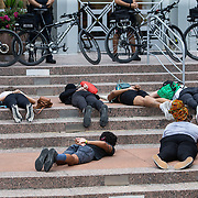 Demonstrators protest at Orlando City Hall on Wednesday, June 3, 2020, in Orlando, Fla., over the death of George Floyd. Floyd died after being restrained by Minneapolis police officers on May 25.  (Alex Menendez via AP)