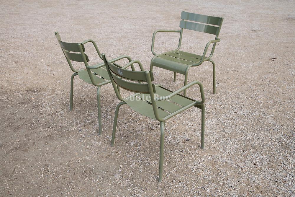 3 empty metal outdoor chairs