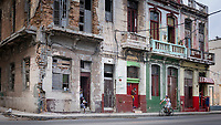 Residents in doorways of a delapitaed apartment building in Centro Havana.