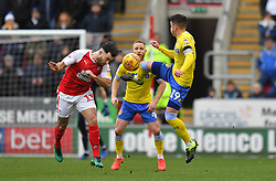 Leeds United's Pablo Hernandez (right) battles with Rotherham United's Richie Towell during the FA Cup fourth round match at the AESSEAL New York Stadium, Rotherham.
