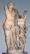 Mable statue of Apollo holding a kithara. Roman copy of the 2nd century AD of a Hellenistic original of about 200-150 BC From the temple of Apollo, Cyrene In this elaborately carved figure, the iconographical features of both Apollo and Dionysus, the wine-god, have been fused; the slipping himation and the sensual treatment of the flesh are typical of Dionysus, while the kithara and quiver characterise Apollo.