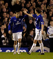Photo: Jed Wee.<br /> Everton v Millwall. The FA Cup. 18/01/2006.<br /> <br /> Everton's Per Kroldrup (R) congratulates goalscorer Tim Cahill.