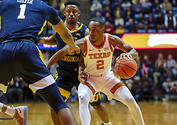 Feb 9, 2019; Morgantown, WV, USA; Texas Longhorns guard Matt Coleman III (2) drives down the lane during the first half against the West Virginia Mountaineers at WVU Coliseum. Mandatory Credit: Ben Queen-USA TODAY Sports