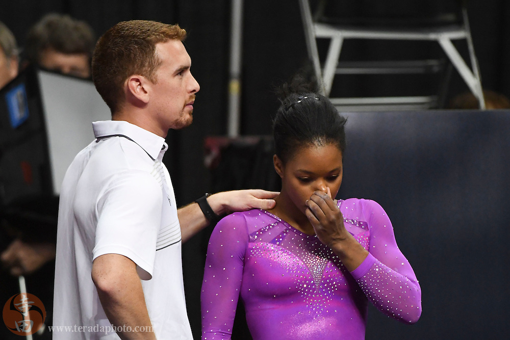 July 8, 2016; San Jose, CA, USA; Gabby Douglas (right), from Tarzana, CA, reacts with coach Christian Gallardo (left) after the balance beam in the women's gymnastics U.S. Olympic team trials at SAP Center.