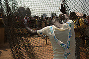A man stands by a fence at the edge of a camp for internally displaced persons (IDPs) at the airport of the capital Bangui January 21, 2014.