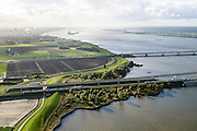 Nederland, Noord-Brabant, Gemeente Moerdijk, 23-10-2013; Moerdijkbruggen over het Hollandsch Diep. Toerit Spoorbrug Hollandsch Diep met twee treinen, toerit HSL-brug, Verkeersbrug met autosnelweg A16.<br /> Moerdijk bridges over the Hollands Diep. From bottom to top: Railway bridge Hollands Diep, HSL bridge, road bridge A16 motorway.<br /> luchtfoto (toeslag op standard tarieven);<br /> aerial photo (additional fee required);<br /> copyright foto/photo Siebe Swart