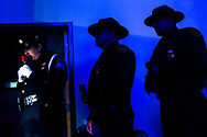 A member of U.S. Customs and Border Protection's Honor Guard holds a rose as names of fallen peace officers are called out during the Southern New Mexico Fallen Peace Officers Memorial at the Real Life Church in Las Cruces, New Mexico, Tuesday, May 7, 2019.<br /> <br /> Over 50 officers from different agencies in southern New Mexico and El Paso County, including those that were killed in the line of duty and others that died of natural causes in the past year, were honored during the evening ceremony.