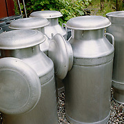 Milk churns outside the West Highland Dairy in the village of Achmore by the Kyle of Lochalsh in the Scottish Highlands. Owned by Kathy and David Biss, the West Highland Dairy was established in 1987 and as well as managing their own small commercial dairy business, they have taught a great number of prospective cheesemakers during the last 20 years.