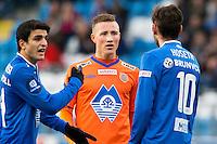 Treningskamp fotball 2014: Molde - Aalesund.  Aalesunds Fredrik Ulvestad (midten) i diskusjon med Magne Hoseth (t.h.) etter en duell i treningskampen mellom Molde og Aalesund på Aker stadion. Mohamed Elyounoussi til venstre.