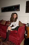 ALBA ARIKHA;, (  amongst photos of her as a young girl is  one by Cartier Bresson). wearing Allegra Hicks. thurloe SSq. London. 12 Occcctober 2004. ONE TIME USE ONLY - DO NOT ARCHIVE  © Copyright Photograph by Dafydd Jones 66 Stockwell Park Rd. London SW9 0DA Tel 020 7733 0108 www.dafjones.com