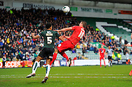 Plymouth Argyle's Curtis Nelson is out jumped by York City's Dave Winfield during the Sky Bet League 2 match between Plymouth Argyle and York City at Home Park, Plymouth, England on 28 March 2016. Photo by Graham Hunt.