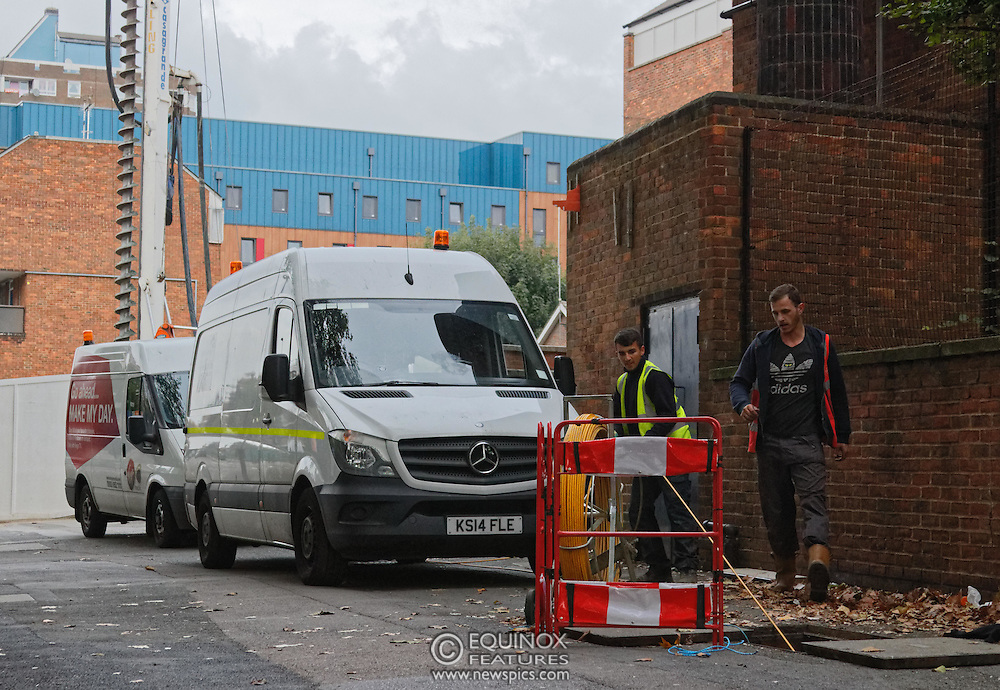 London, United Kingdom - 10 October 2015<br /> Huge drill cuts Virgin fiber cable. Thousand customers without weekend TV and internet. Severed fiber optic cables have caused up to a thousand customers of Virgin Media in Shoreditch and Hackney in London to be left without broadband internet and cable television this weekend. Engineers believe the total loss of service, which continues to be down this Saturday evening, is unlikely to be fixed until Sunday lunchtime at the earliest. The damage to a primary cable carrying 96 fiber optic cables including some belonging to the EE mobile network was caused by a huge drilling rig on a nearby construction site for a block of flats being built by Formation Construction Ltd. An engineer working on the drilling site claimed they had not 'drilled through the cable'. 'We damaged the cable' he said. He then demanded we delete images of the offending drilling rig. Technicians working on behalf of Virgin Media were working hard to replace the damaged cables. Virgin Media press office did not respond to repeated requests to speak with them for comment today.<br /> (photo by: EQUINOXFEATURES.COM)<br /> <br /> Picture Data:<br /> Photographer: Equinox Features<br /> Copyright: ©2015 Equinox Licensing Ltd. +448700 780000<br /> Contact: Equinox Features<br /> Date Taken: 20151010<br /> Time Taken: 17453526<br /> www.newspics.com