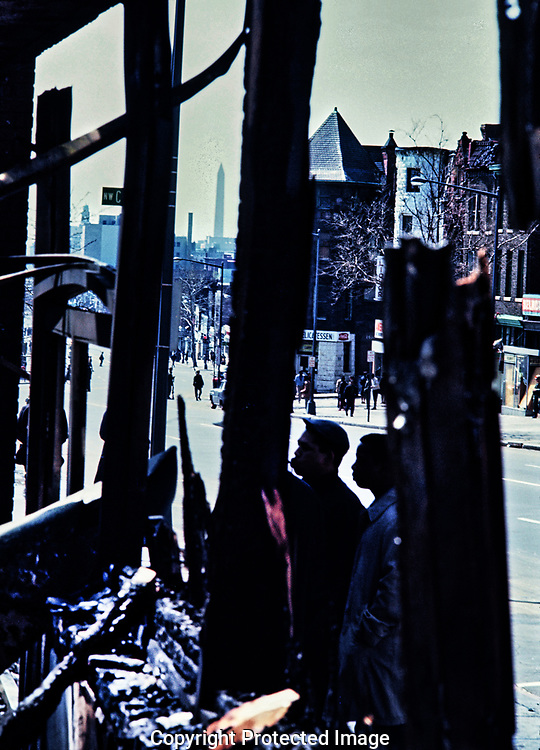 Surveying the damage on 7th Street NW and Florida Avenue NW the day after Dr.. Martin Luther King jr was assassinated.<br /><br />Photo by Dennis Brack bb72