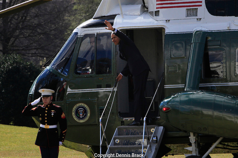 President Barack Obama waves at the door of  Marine One on the South Lawn of the White House on February 26,2016.  photo by Dennis Brack