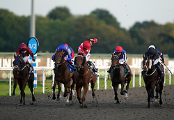 Fast Style and Trevor Whelan (centre, red/white) coming home to win the Unibet Extra Place Offers Every Day Nursery at Kempton Park Racecourse, Surrey. Picture date: Monday October 11, 2021.
