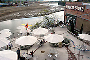 """Redevelopment along the Napa River includes a hotel, restaurants and shops in the historic Hatt building in downtown Napa as seen in this March 27, 2004 photo.  Riverbank terracing, which provides room for excess water, can be seen on the opposite bank of the river at lowtide, with the second terrace unflooded. The terraces flood during high tide, and provide wetlands in low tide. Napa's unique """"Living River"""" flood control project allows water to flow in its historical channel, creating wetlands, restoring the life of the river, and protecting property from floods."""