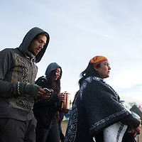 Adriana Betti leads a group through the camp in Standing Rock, ND Tuesday morning for the daily water ceremony.