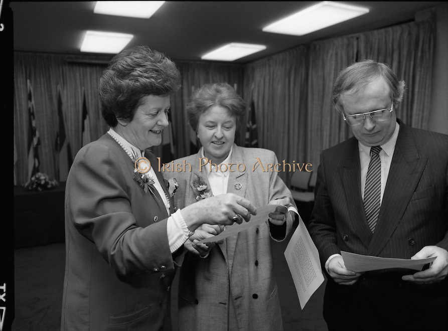 """Irish Laureate Women Of Europe Award. (T10)..1989..17.11.1989..11.17.1989..17th November 1989..Speculation regarding the Irish Laureate for the 1989 Women of Europe Award ended today when the Minister for Education, Ms Mary O'Rourke TD, announced that the Irish Laureate for this year is Grainne Kenny. Founder member of EURAD (Europe Against Drugs), and well known for her work as """"The drugs lady"""" in Ireland, Grainne Kenny has been involved in the fight against drugs since 1980. She helped form CAD, Community Action and Drugs and later EURAD. EURAD is has the active co-operation of both the European Commission and Parliament...Image shows the Minister for Education, Mary O'Rourke (left) preparing for the presentation with members of the organising committee."""