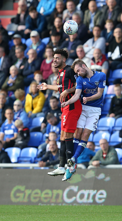 Blackburn Rovers' Derrick Williams and Oldham Athletic's Cameron Dummigan<br /> <br /> Photographer Stephen White/CameraSport<br /> <br /> The EFL Sky Bet League One - Oldham Athletic v Blackburn Rovers - Saturday 14th October 2017 - Boundary Park - Oldham<br /> <br /> World Copyright © 2017 CameraSport. All rights reserved. 43 Linden Ave. Countesthorpe. Leicester. England. LE8 5PG - Tel: +44 (0) 116 277 4147 - admin@camerasport.com - www.camerasport.com