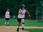 Elli Rose Focht plays baseball for her school team.