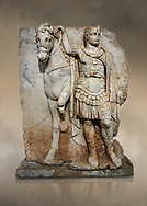 Roman Sebasteion relief sculpture of  an Imperial prince as Diokouros, Aphrodisias Museum, Aphrodisias, Turkey.  Against an art background.<br /> <br /> An imperial youth wearing a military cloak and cuirass of a commander holds the reins of hios horse. This panel is next to a Claudius panel so is probably of Britanicus or Nero the emperors son and intended successor .<br /> <br /> If you prefer to buy from our ALAMY STOCK LIBRARY page at https://www.alamy.com/portfolio/paul-williams-funkystock/greco-roman-sculptures.html . Type -    Aphrodisias     - into LOWER SEARCH WITHIN GALLERY box - Refine search by adding a subject, place, background colour, museum etc.<br /> <br /> Visit our ROMAN WORLD PHOTO COLLECTIONS for more photos to download or buy as wall art prints https://funkystock.photoshelter.com/gallery-collection/The-Romans-Art-Artefacts-Antiquities-Historic-Sites-Pictures-Images/C0000r2uLJJo9_s0