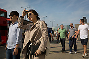 Foreign visitors and commuters walk southwards over London Bridge, from the City of London - the capital's financial district founded by the Romans in the 1st century - to Southwark on the south bank, on 3rd September 2018, in London, England.