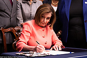 January 15, 2020 - Washington, DC, United States:  U.S. Representative Nancy Pelosi (D-CA) signing the articles of impeachment at the engrossment ceremony for signing of the articles of impeachment.