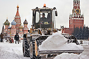 Moscow, Russia, 22/01/2006..Street cleaners clear snow from Red Square as a Siberian weather front brings temperatures down to minus 36C in the Russian capital and leads to power cuts in the city.