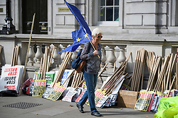 © Licensed to London News Pictures. 31/08/2019. London, UK. Protestors gather near 10 Downing Street and the Houses of Parliament in Westminster, central London to demonstrate as part of a nationwide 'Stop The Coup' day of action against Boris Johnson's plans to suspend parliament. More than 80 demonstrations are planned across the UK in response to government plans to prorogue parliament. Photo credit: Ben Cawthra/LNP