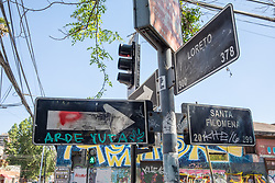 """Street Signs With """"Burn Police"""" Tag"""
