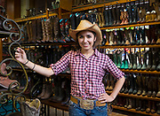 Cowgirl selling cowboy boots in Dallas.