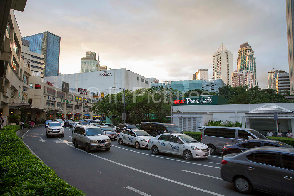 A view of the Landmark Hotel beside Glorietta Mall on Palm Drive, Makati, Metro Manila, Philippines. At the side of the road, called Street Ayala, is a UCC Park Cafe, which is part of the Glorietta Complex in Makati.
