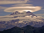 Mount Rainier from the Puyallup Ridge fire lookout west of the 14,410 ft volcano with a lenticular cloud over the mountain. Also in view in the image are the three peaks that make up the summit: Columbia Crest, Point Success, and Liberty Cap.  The large Glacier is the Puyallup Glacier.