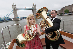© licensed to London News Pictures. London, UK 12/06/2012. Musicians from the City?s Guildhall School conservatoire posing while on their way to rehearsals for a thunderous performance of the Tchaikosky?s 1812 Overture which will open the Celebrate the City festival on Thursday 21 June. Photo credit: Tolga Akmen/LNP