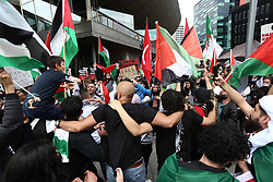 © Licensed to London News Pictures. 29/05/2021. Salford, UK.  Protesters stop to chant at a 'Protest for Palestine' outside the BBC studios in Media City. Pro-Palestine demonstrations have been taking place worldwide in the wake of Israel's 11 day bombardment of Gaza which resulted in hundreds of civilian deaths. Photo credit: Adam Vaughan/LNP