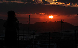 August 21, 2017 - Asturias, asturias, Spain - Solar Eclipse 2017 seen in the port off Gijon  (Credit Image: © Pacific Press via ZUMA Wire)