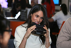 © Licensed to London News Pictures. 08/03/2018. Birmingham, UK. MEGAN MARKLE tries on a virtual headset with students from Blessed Edward Oldcorne School, while attending Stemettes International Women's Day event at Millennium Point in Birmingham. Photo credit: Dave Warren/LNP