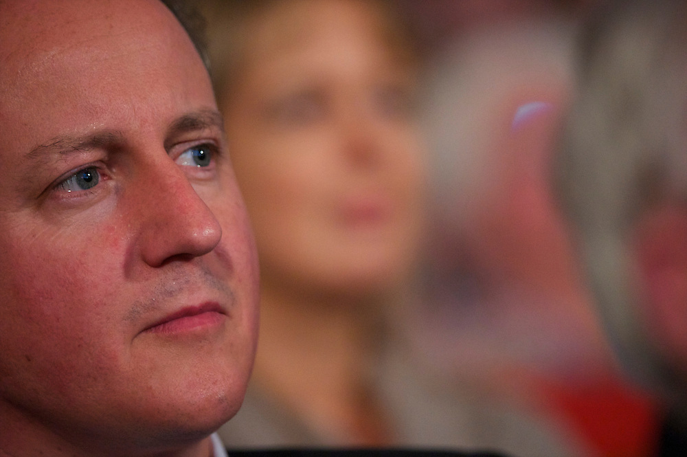 Prime Minister David Cameron listens to speeches on the first day of the Conservatives Party Conference at the ICC, Birmingham, UK on October 3, 2010.  This is the first conference since the government coalition with the Liberal Democrats.